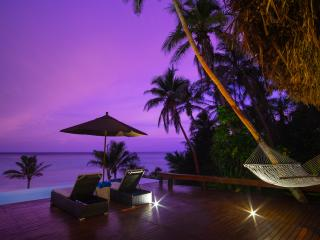 Beachfront Honeymoon Bure at Night