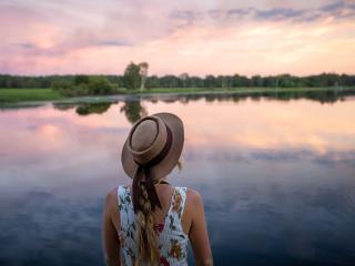 Woman Looking into the Horizon at Yellow Water - Tourism NT/Katie Goldie