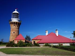 Barrenjoey Head Lighthouse overlooks Broken Bay and Ettalong Beach
