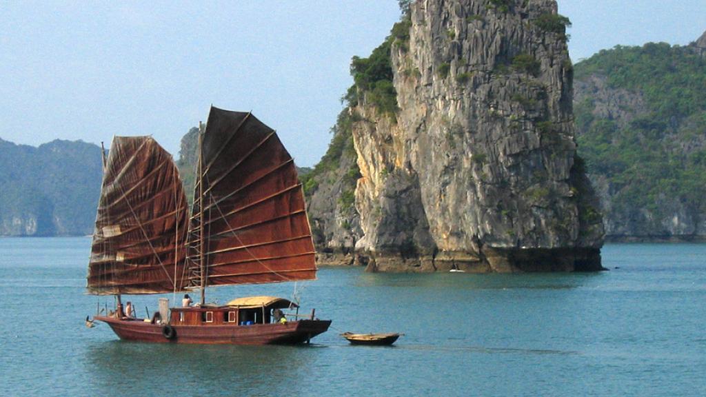 Junk Boat Sailing past Ha Long Bay