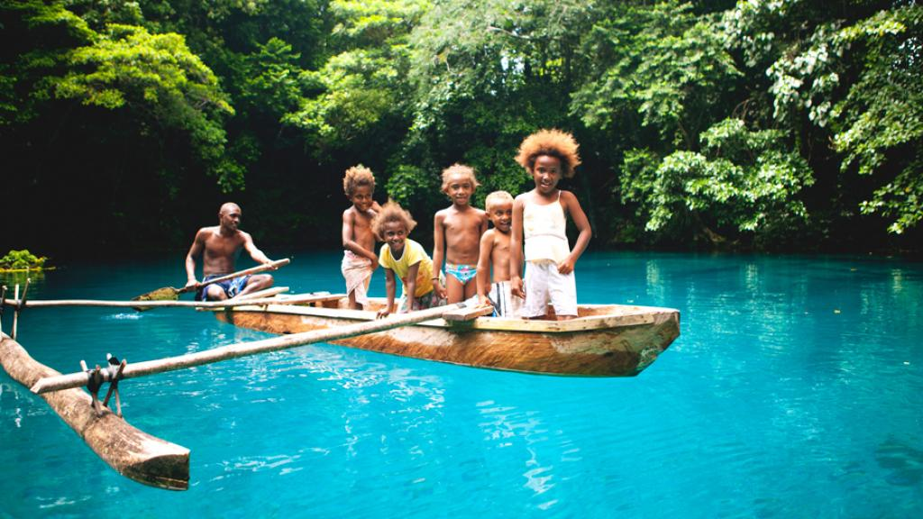 Kids in Canoe Blue Hole Santo