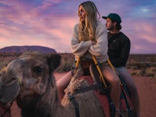 Couple on tour with Uluru Camel Tours - Tourism NT - Nic Morley