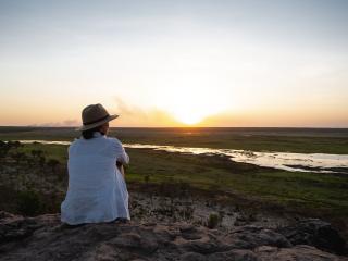 Kakadu - Woman watching the sunset at Ubirr