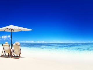 Couple Relaxing in Deck Chairs Beach