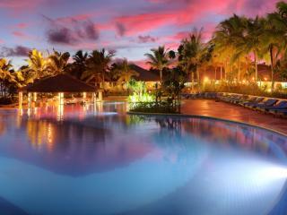 Warwick Le Lagon Resort & Spa - Pool at Sunset
