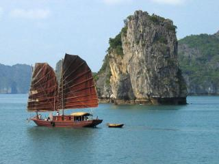 Junk Boat Sailing past Ha Long Bay